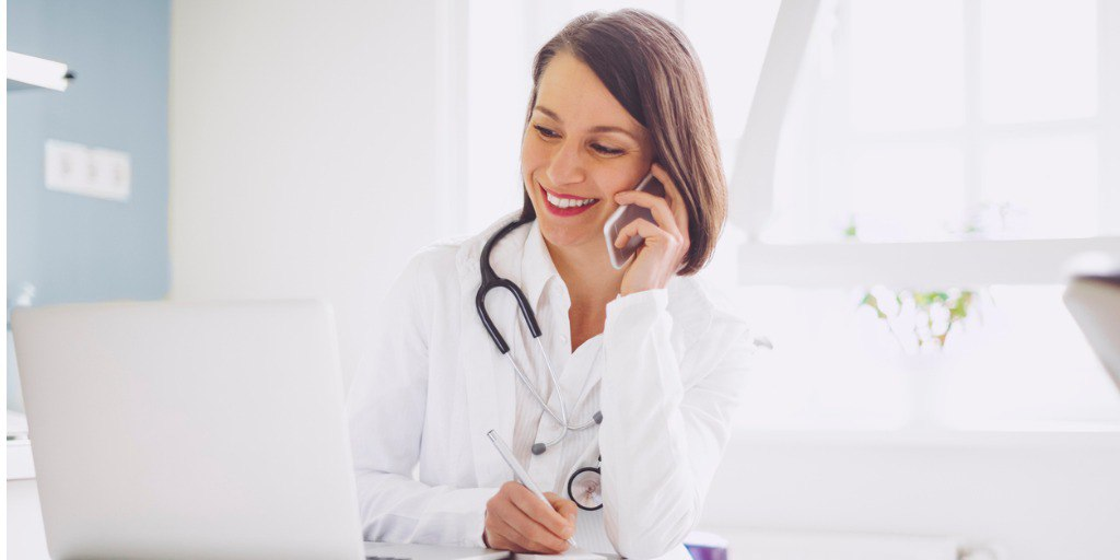 doctor-is-on-the-phone-and-checking-medical-records-picture-id1057170932