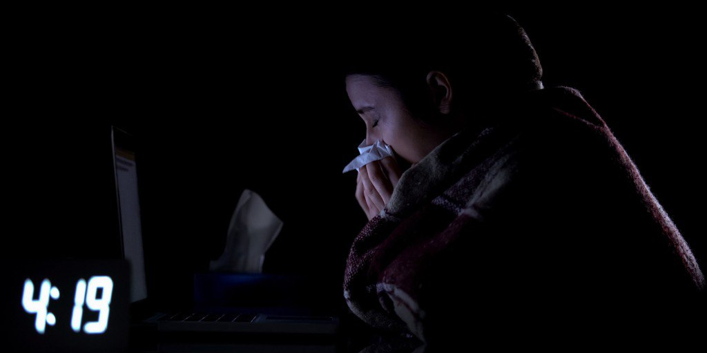 technical-support-female-worker-suffering-cold-and-sneezing-working-picture-id1183371939