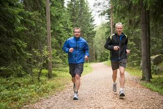 men jogging on trail
