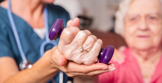 elderly woman does preventative arthritis exercises