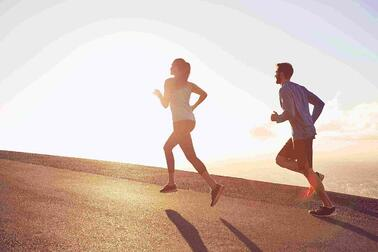 man and woman running up hill