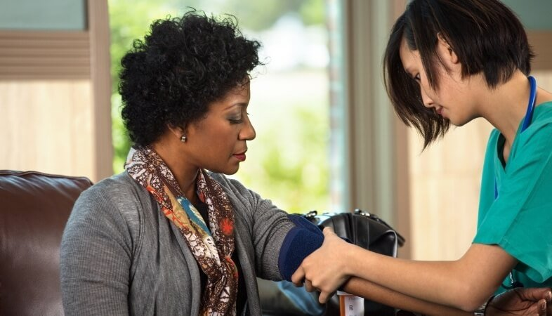 woman-getting-her-blood-pressure-tested